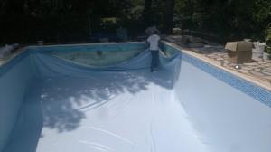 suite pose liner piscine